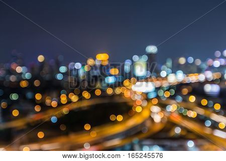 Aerial view blurred lights highway interchanged with city downtown background night view