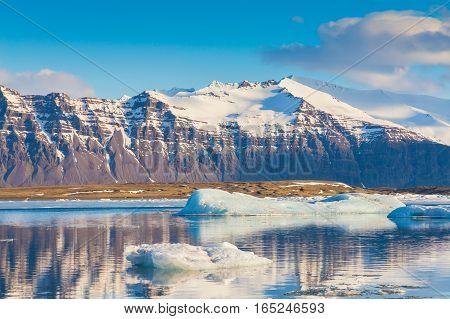 Iceland winter lake with mountain background natural winter season landscape background