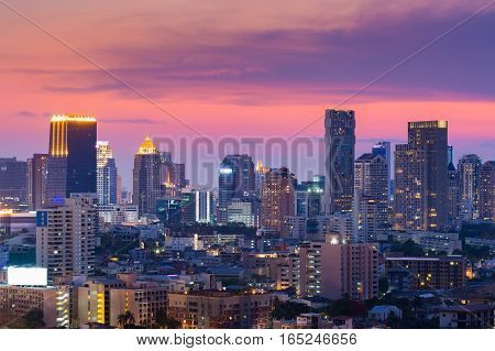 Beautiful after sunset sky over Bangok office building business downtown Thailand
