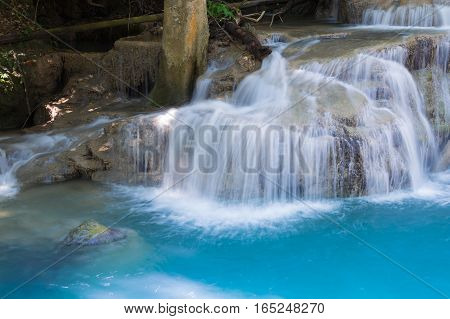 Natural blue stream waterfall close up in deep forest natural landscape background