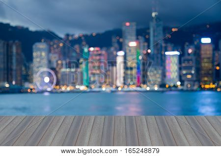 Opening woode floor Blurred lights Hong Kong city downtown abstract background