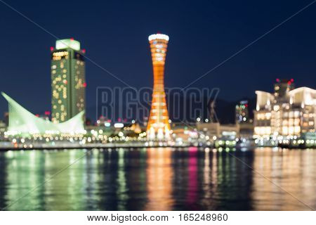 Blurred lights Kobe port city with reflection at night abstact background