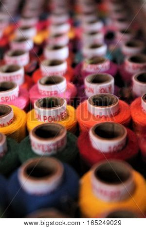 haberdashery cotton spools many rainbow colors shop display