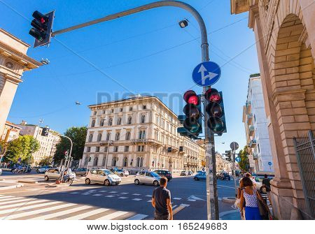 MILAN ITALY - September 06 2016: Traffic light shows the red light on the crossroad on Avenue Buenos Aires (Corso Buenos Aires) and street Bastioni di Porta Venezia