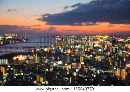 Blurred lights Osaka city aerial view with beauty sunset sky background