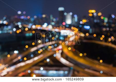 Abstract blurred light highway intersection and city downtown background