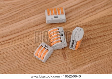A four of Compact Splicing Connectors on wooden background.