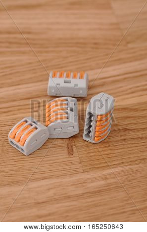 A four of Compact Splicing Connectors on wooden background. poster