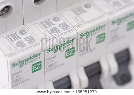 SARANSK, RUSSIA - JANUARY 13, 2017: Close up Schneider Electric one-pole circuit breaker lineup. Selective focus.