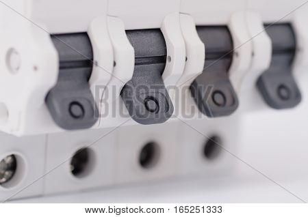 Close up circuit breakers at off position. Selective focus.