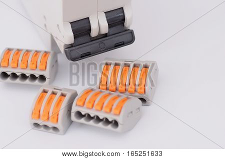 Close up circuit breaker and compact splicing connectors. poster