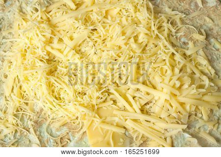 Appetizing pita ground and sliced cheese horizontal view closeup