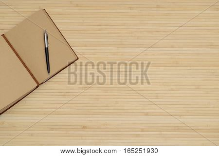 Light Wooden Table, With A Notepad And Pen