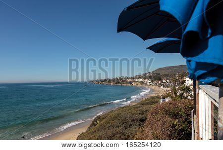 View of Main Beach in Laguna Beach from a restaurant under an umbrella