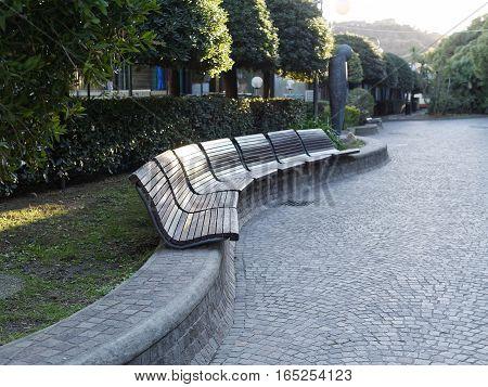 beautiful wooden bench in a arenzano garden in genova