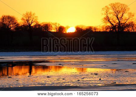 A beautiful sunset on the lake in winter