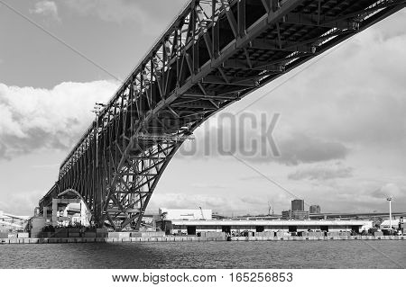 Black and White Minato Bridge (red bridged) in Osaka port Japan