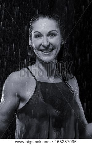 Beautiful woman in rain at night getting very wet artistic conversion