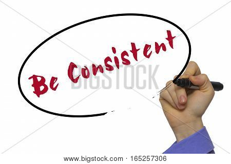 Woman Hand Writing Be Consistent On Blank Transparent Board With A Marker Isolated Over White Backgr