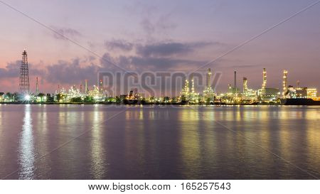 Panorama Oil refinery river front after sunset industrial landscape background