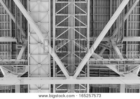 Steel construction background under the bridge construction background