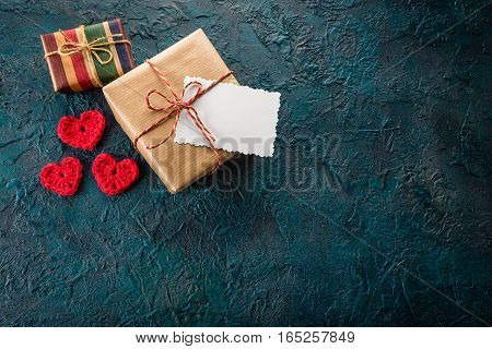 Crochet valentine hearts gift box and a greeting card on a dark background