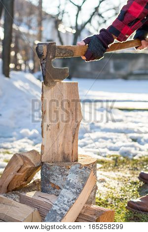 Man Chopping Firewood In The Yard