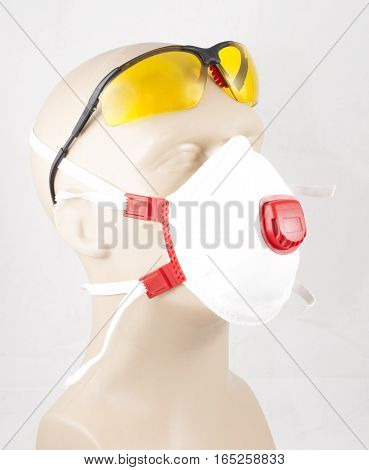 eyewear and white dust mask on mannequin