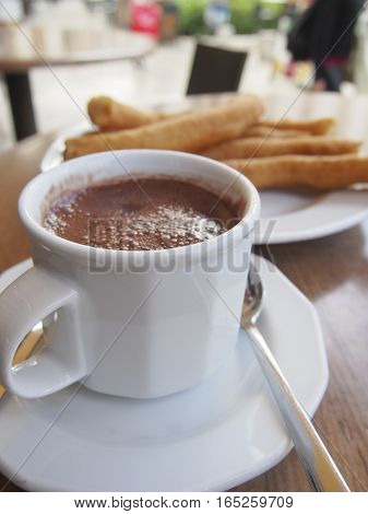 Chocolate con churros is a popular dessert in Spain. The fried dough churros are meant to be dipped in the rich hot chocolate.
