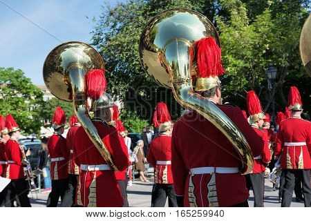 CORFU GREECE - APRIL 30, 2016: Philharmonic musicians playing in Corfu Easter holiday celebrations. Corfu has a great tradition in music with 18 philharmonic bands playing a major role on the island's music education and culture.