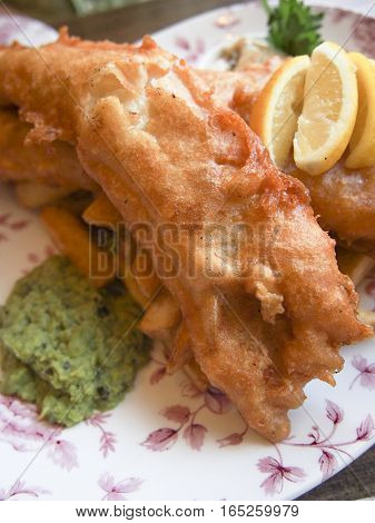 Fish 'n' chips is a very popular meal in Britain made of fried cod and potatoes.