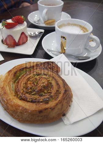 French pastries and coffee at a cafe.