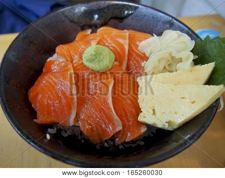 Donburi is a traditional Japanese dish of rice with meat on top. Hokkaidon, a specific type of donburi, is made with raw salmon.