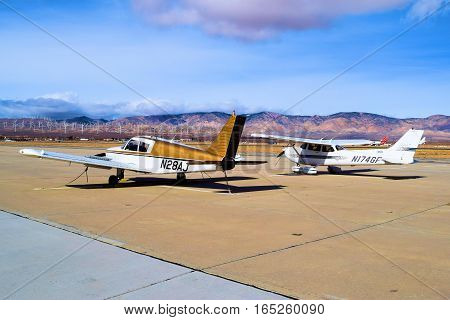 January 12, 2017 in Mojave, CA:  Small single engine turboprop planes parked on the tarmac at Mojave Airport where the public can fly and park their aircraft including flight lessons taken in Mojave, CA
