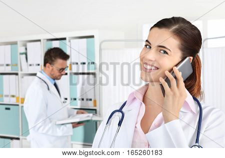 Doctor smiling on the phone concept of medical booking