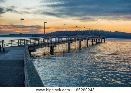 A view of the pier at Des Moines Washington at sunset.