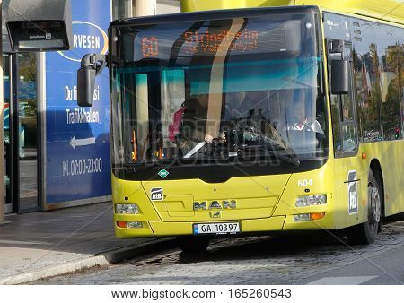 Trondheim Norway - September 30 2016: People and a city bus on line 60 in service for Atb stoped at the bus station near the Trondheim central station.