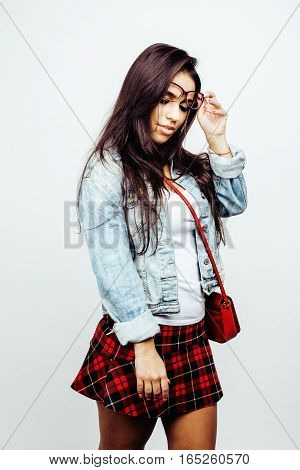 young happy smiling latin american teenage girl emotional posing on white background, lifestyle people concept, school uniform wearing glasses close up