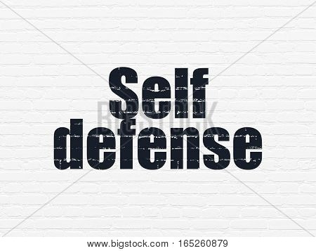 Safety concept: Painted black text Self Defense on White Brick wall background