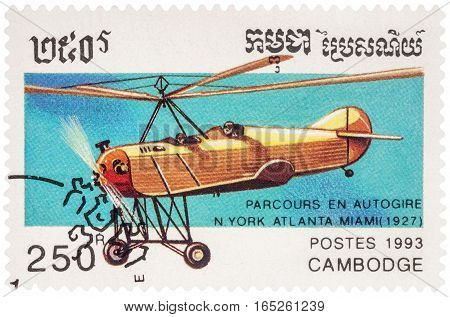 MOSCOW RUSSIA - January 10 2017: A stamp printed in Cambodia shows autogyro dedicated flight from New York Atlanta Miami in 1927 series