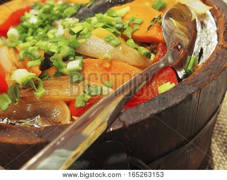 Khorkhog is a traditional Mongolian dish made by cooking meat and vegetables on hot stones.