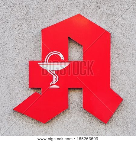 Red Pharmacy Store Sign In Germany On The Wall closeup