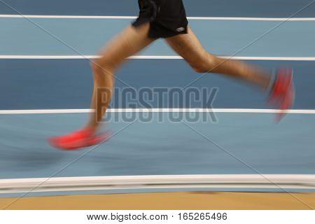 Blured Athletes Running