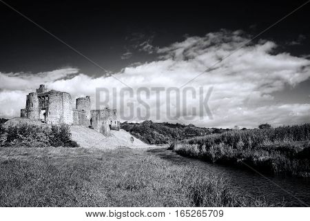 Kidwelly, Wales, UK September 25, 2015 : Black and white landscape image showing Kidwelly Castle, Kidwelly, Carmarthenshire, Wales, UK by the River Gwendraeth