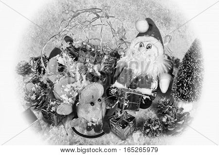 Black and white image of Father Christmas and Rudolph collapsed exhausted during the Christmas festival