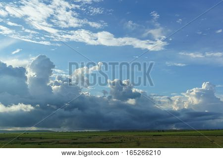 Blue spring sky with fluffy Cumulus clouds at sunset