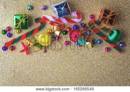 Christmas and new year wooden background banner with gift box daisy flower candy ball and decoration on vintage Gold sparkle paper background.