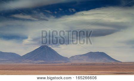 Saucer clouds over the volcano Licancabur Atacama desert Chile