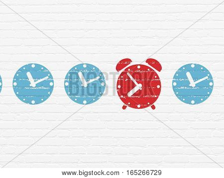 Timeline concept: row of Painted blue clock icons around red alarm clock icon on White Brick wall background