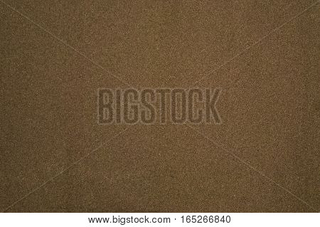 Wall covered with a textured background from an old brown cork cover.